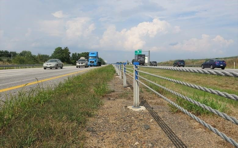 Crews installing median barriers on route work to