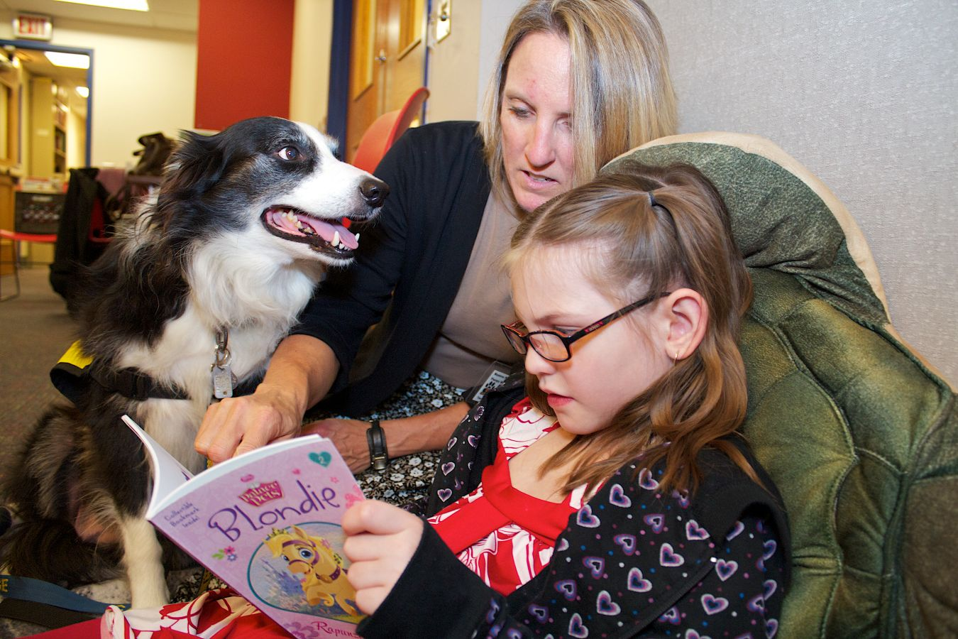 Abigail Horst reads to Widget, the reading dog