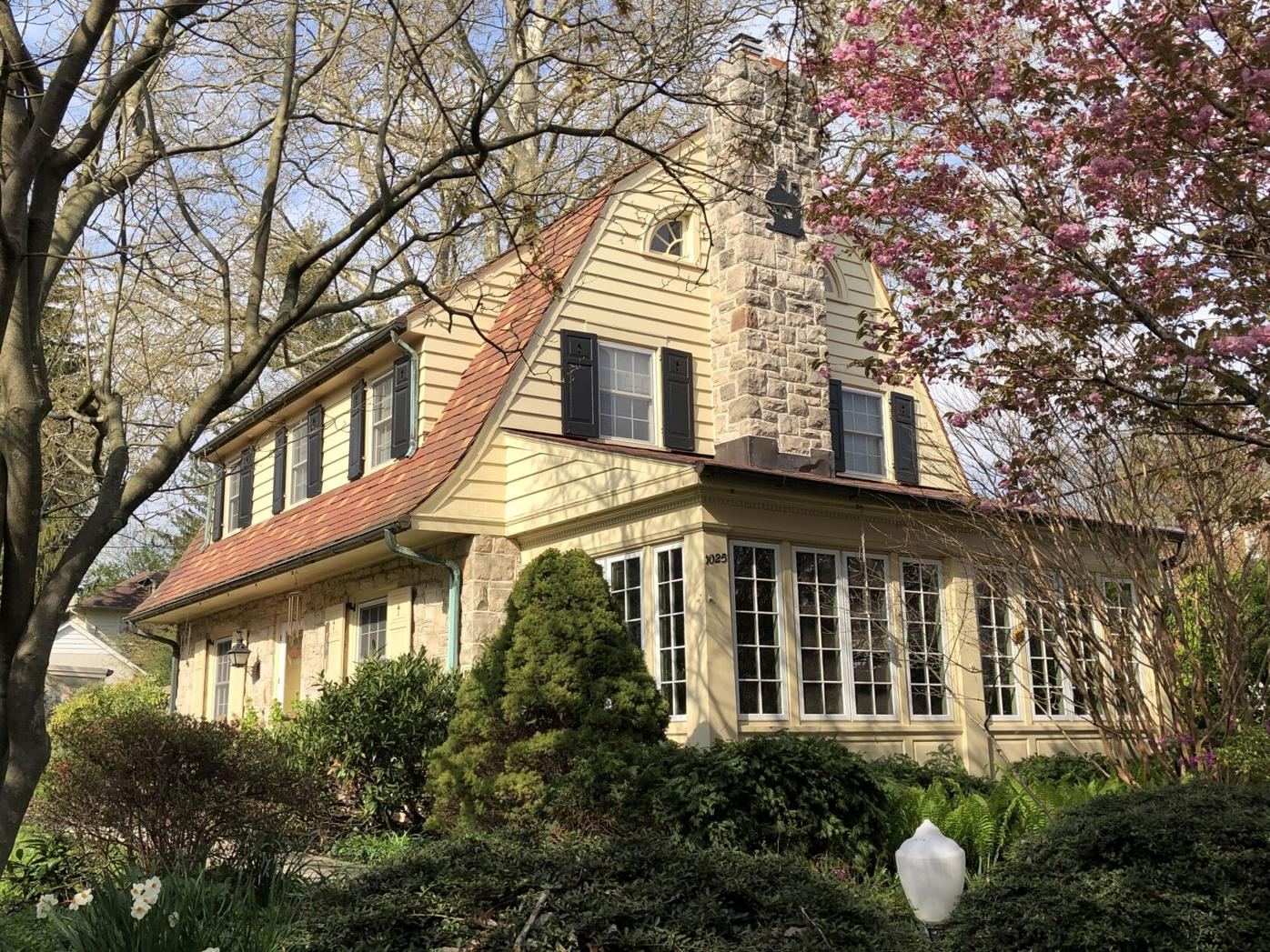 Dutch Colonial Revival with flared eaves