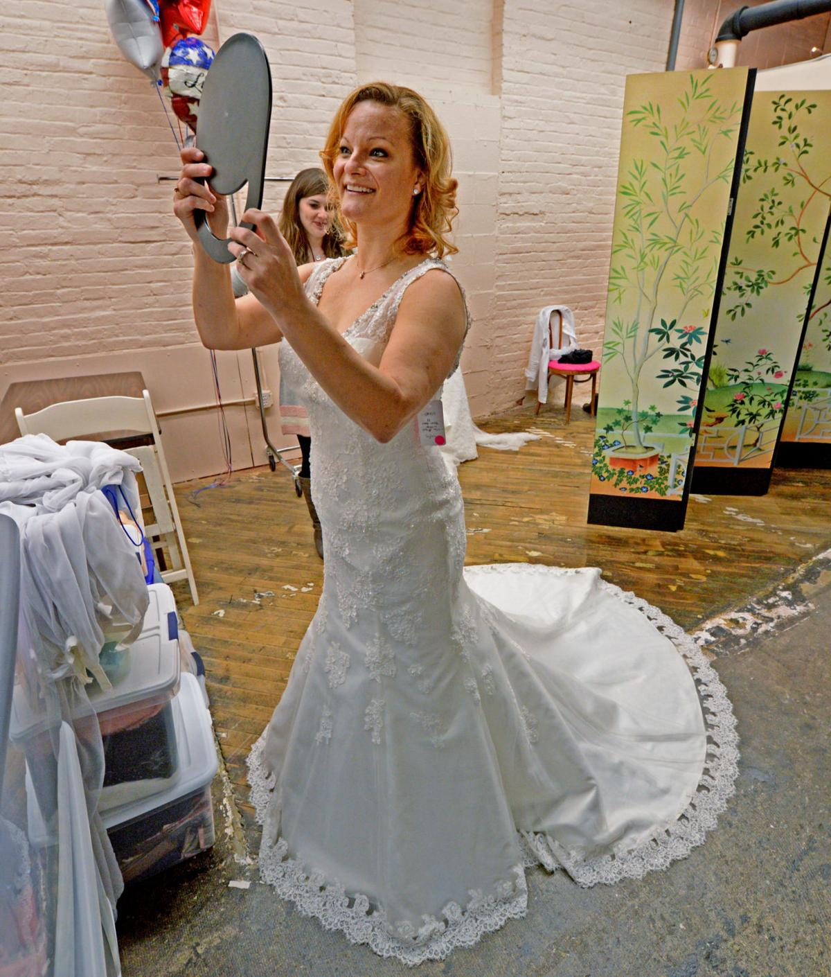Military brides take home free wedding dresses on veterans for Free wedding dresses for military brides