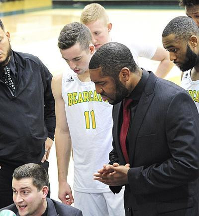 SVC coaches talk to players during timeout