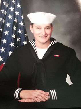 Derry grad quarantined with crew from naval aircraft carrier