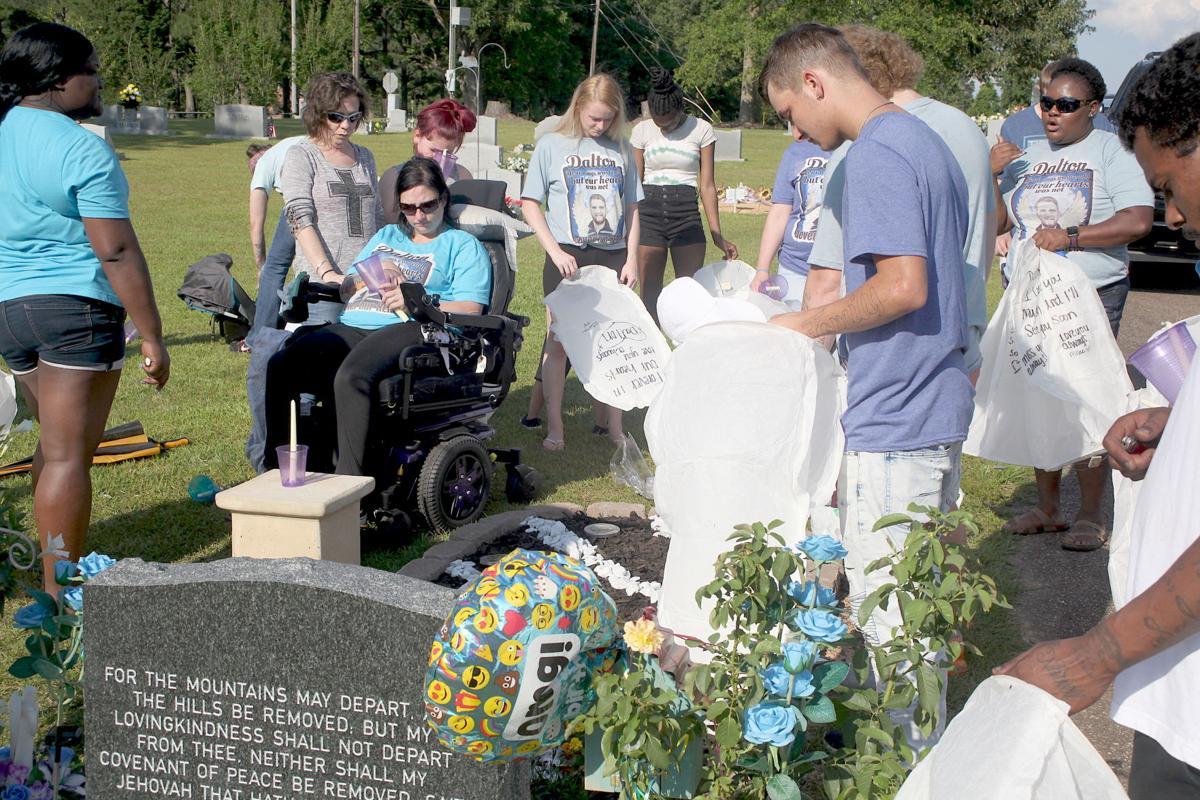 1-Family and friends say a prayer at Dalton White's graveside. (Photo by Mark Thornton).jpg