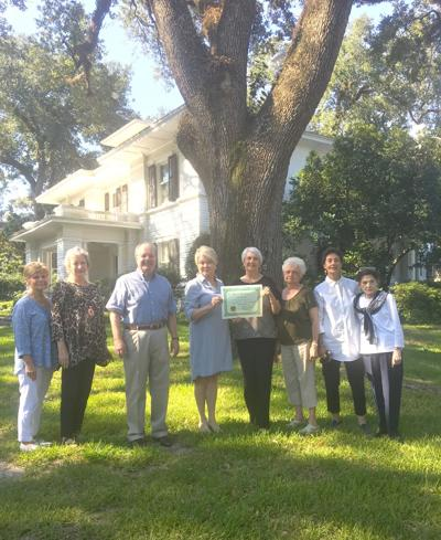 Presenting the Societe Des Arbres certificate of registration to Barbara Sauls, chair- man of the board of directors of the Lauren Rogers Museum of Art is Pat Myers of Park Place Garden Club. Also pictured are, from left Carol Henley, Ellen Brown, Robert Sumrall, representative of the museum board of directors, Sauls, Myers, Dave Ann Wheat, Cynthia Sheppard and Peggy Gatlin, co-chairman of the Histori- cal Tree committee. The certificate will be displayed in the Rogers Green House.