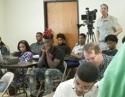 A PBS videogra- pher films a class Thursday at South- eastern Bible College in Laurel. (Photo by K.D. Parker)