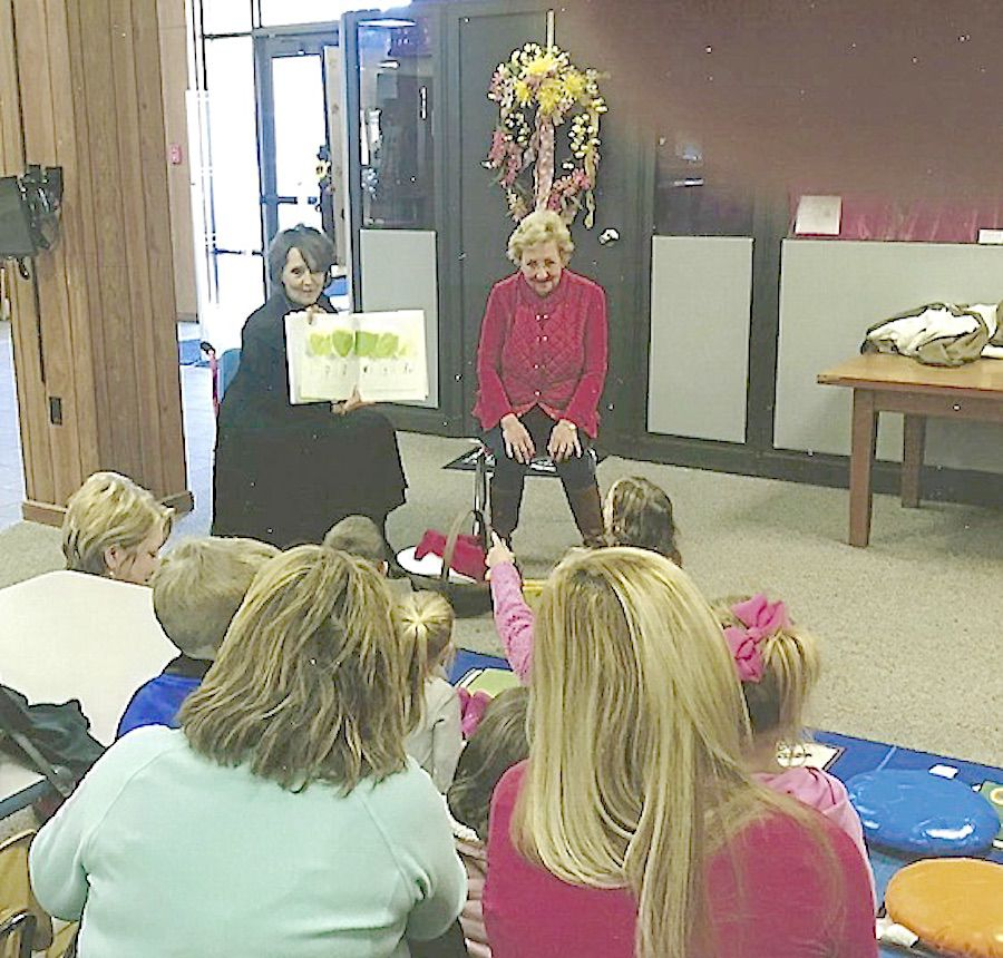 "Simply Southern Garrden Club members at the Laurel Jones County Library reading in the ""Totally Tots"" program..jpg"