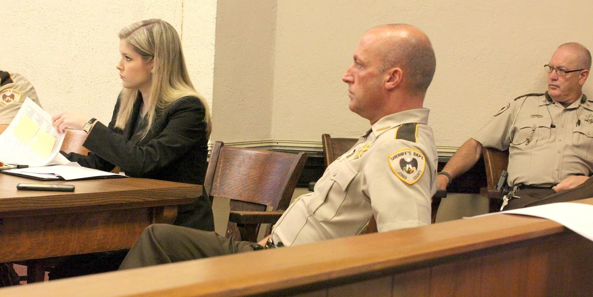 Sheriff Alex Hodge, center, listens to the judge along with attorney Danielle Ashley and Deputy Bob Shoemake.jpg