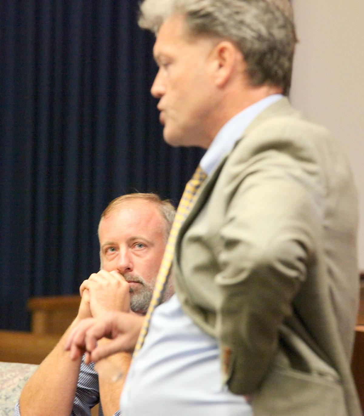 Defendant Greg Burroughs listens as DA Tony Buckley talks about evidence against him in his up- coming manslaughter trial. (Photo by Mark Thornton)