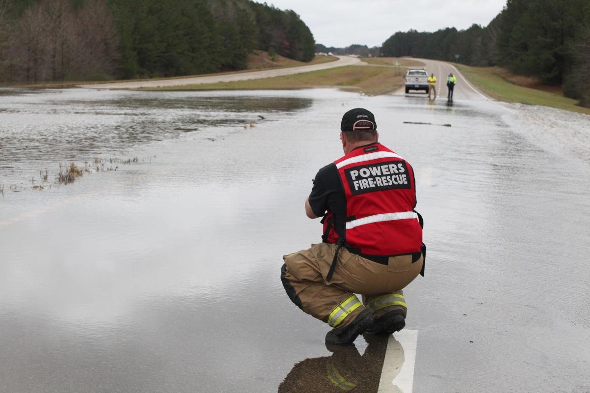 2 Highway 84 East had to be shut down, just east of Magnolia Road, in what is known as the Bogue Homa flats, after water flowed over all four lanes around noon Friday. Longtime residents can't remember a time that has happened. .jpg