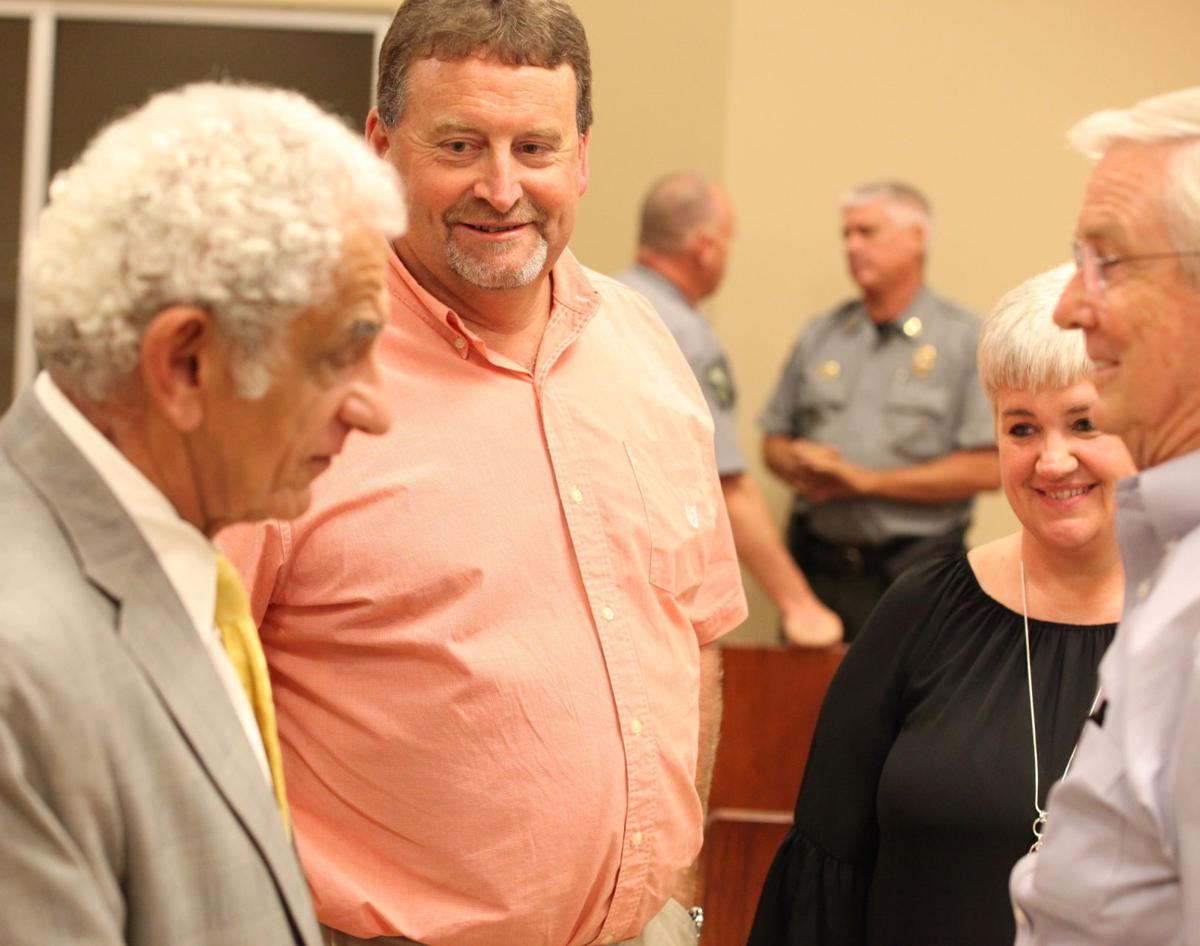 Tim Parker and his wife smile as attorney Joe Sam Frank and retire juge Charles Pickering talk after the ruling. In the backgroun is conservation officer Richard Holifiel an an unidentifed conservation officer..jpg