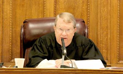 Judge Dal Williamson talks about early releases during an open session of court last Tuesday.