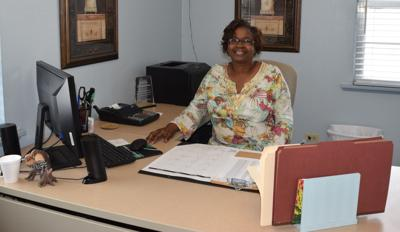 Gwendolyn Thomas sits in her former office at the Laurel Housing Authority. (Photo by Eloria Newell James)