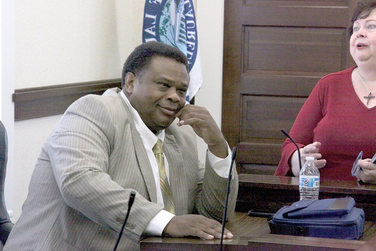 4.8 City Council, Ward 4 Councilman George Carmichael talks with City Clerk Mary Ann Hess after Wednesday morning's meeting. .jpg
