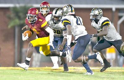 Jones receiver Nataurean Watts (8) heads upfield after making a catch Thursday night vs. Mississippi Gulf Coast. (Photo by jucoweekly.org)
