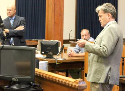 8.11 Burroughs hearing, DA Tony Buckley talks to the judge as defense attorney Tracy Klein, left, and defendant Greg Burroughs look on..jpg