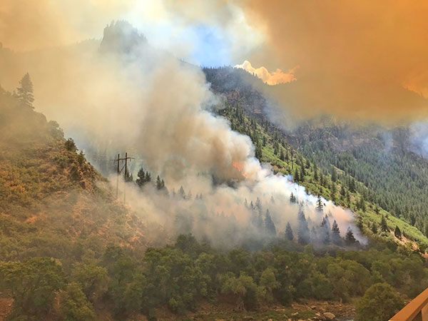 The Grizzly Creek Fire burns on a hillside