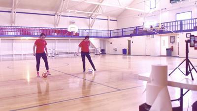Demonstrating soccer drills