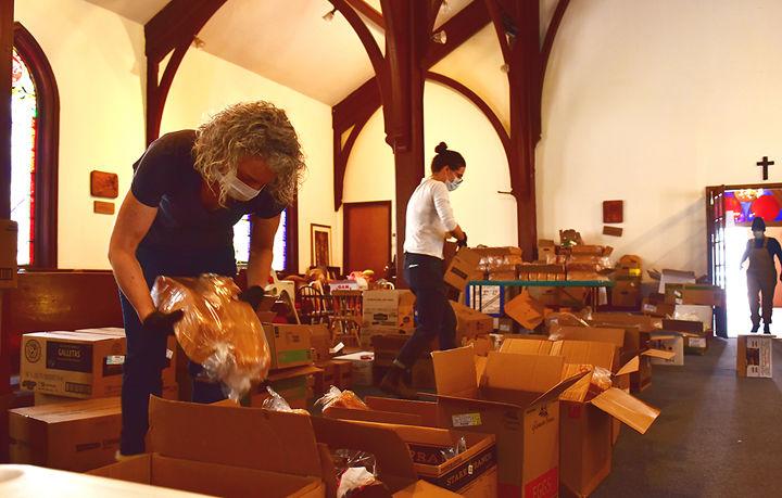 Veronica Rimbert and Emily Olsen pack boxe