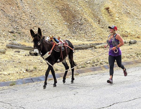 Erin Farrow runs with her burro
