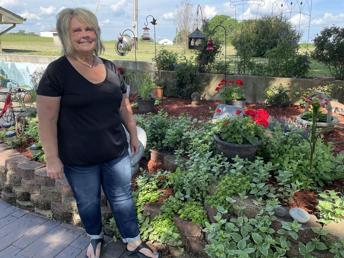 Norma Bledsoe at her flower garden