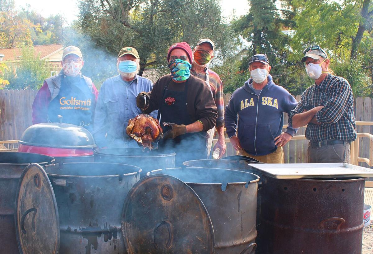 1. Despite modifications from the typical sit-down feast to a drive-through pickup, Mokelumne Hill Community Historical Trust members and volunteers were in high spirits as they prepared for the day bright and early. photo by Dave Gebauer..jpg
