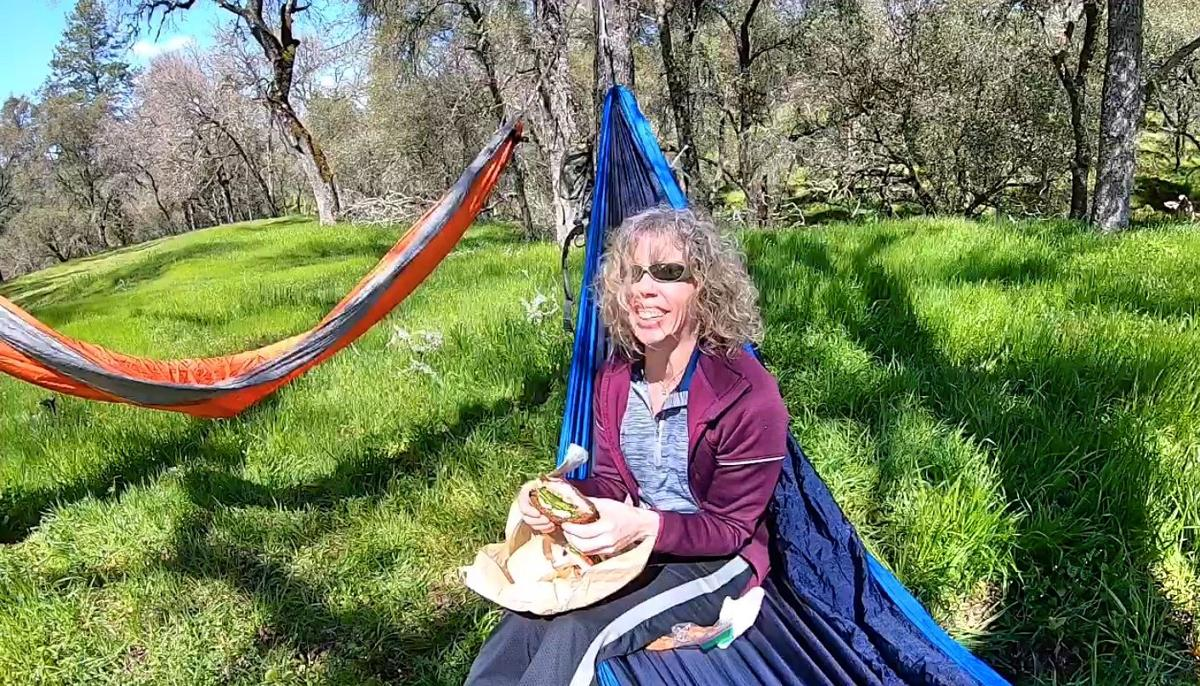 2. Pamela Stroude enjoying lunch on tree-friendly Lazy Monk hammock. Photo by Dave Gebauer..jpg