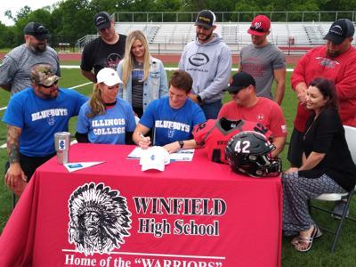 Jake Colbert signs