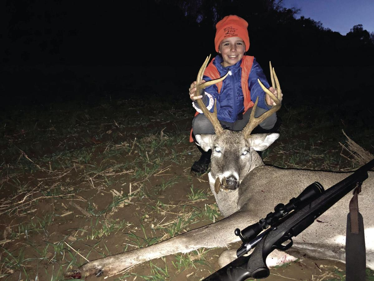 Adelyn Yanick, 10, took his first buck this year.jpg