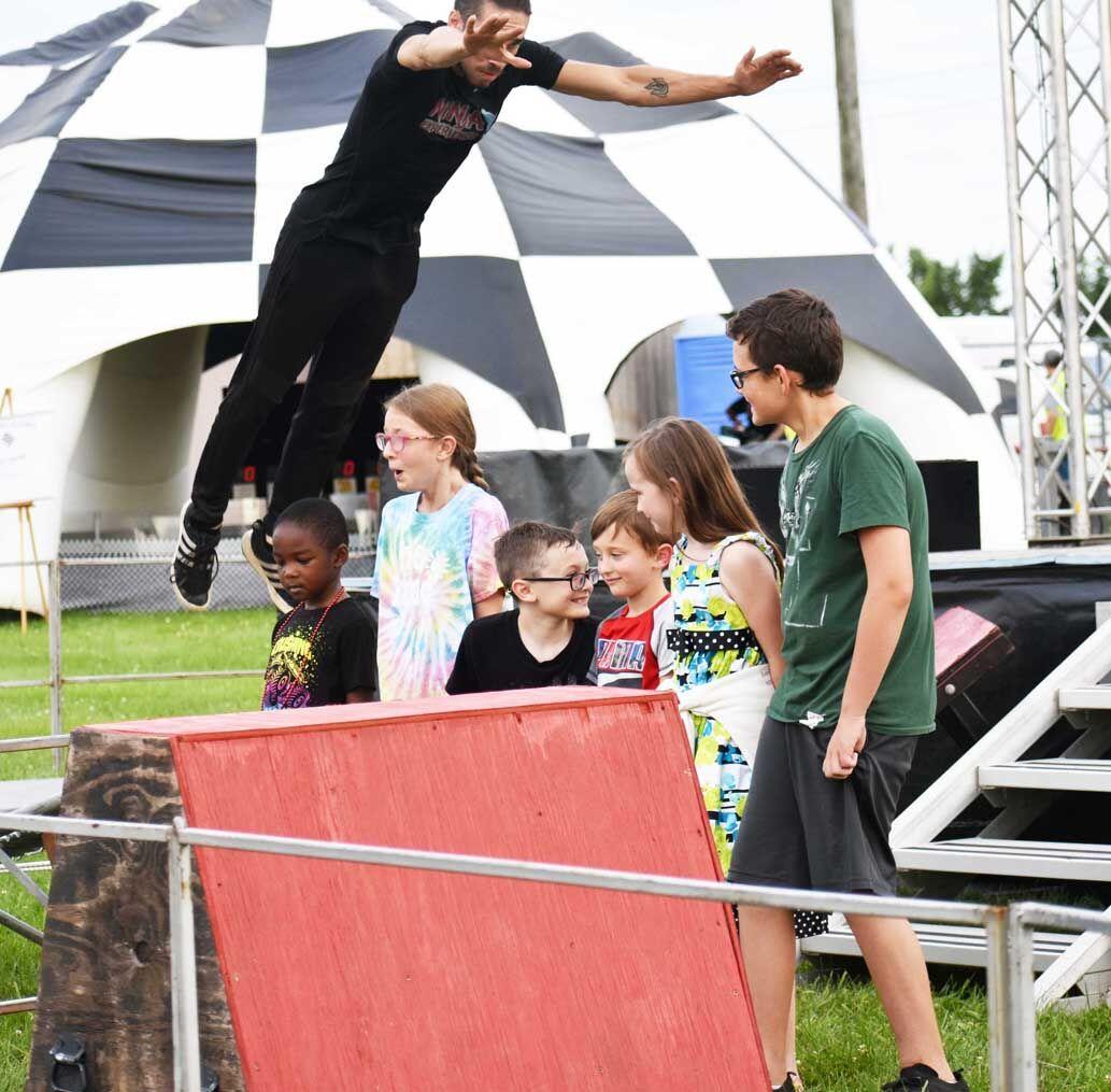Ninja jumping over kids