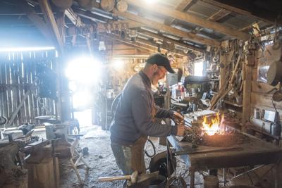 Blacksmith forging new chain for historic cemetary by hand