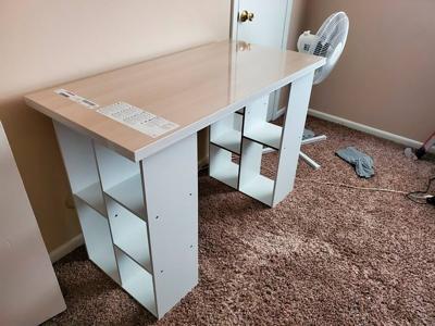 Desk shortage forces folks to get creative