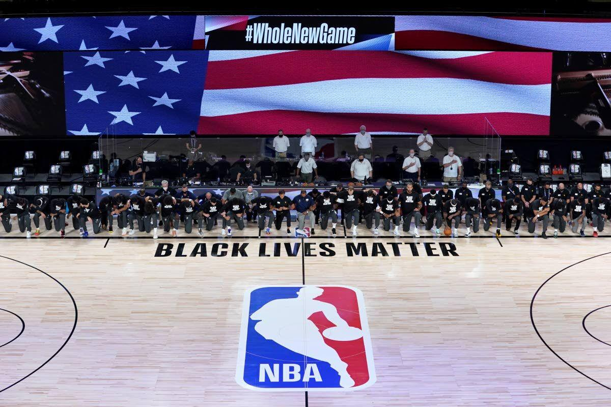 Players, coaches show unity before NBA's reopening night