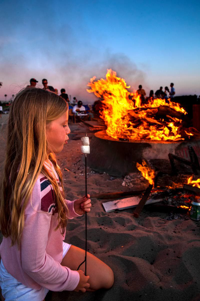 Crazy beach party aglow for summer's end