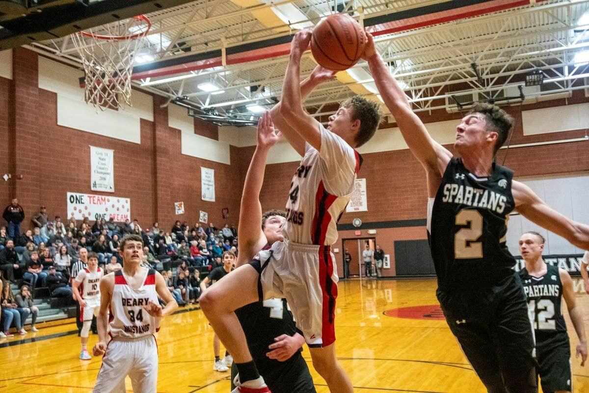 Spartans deliver back-to-back district championships
