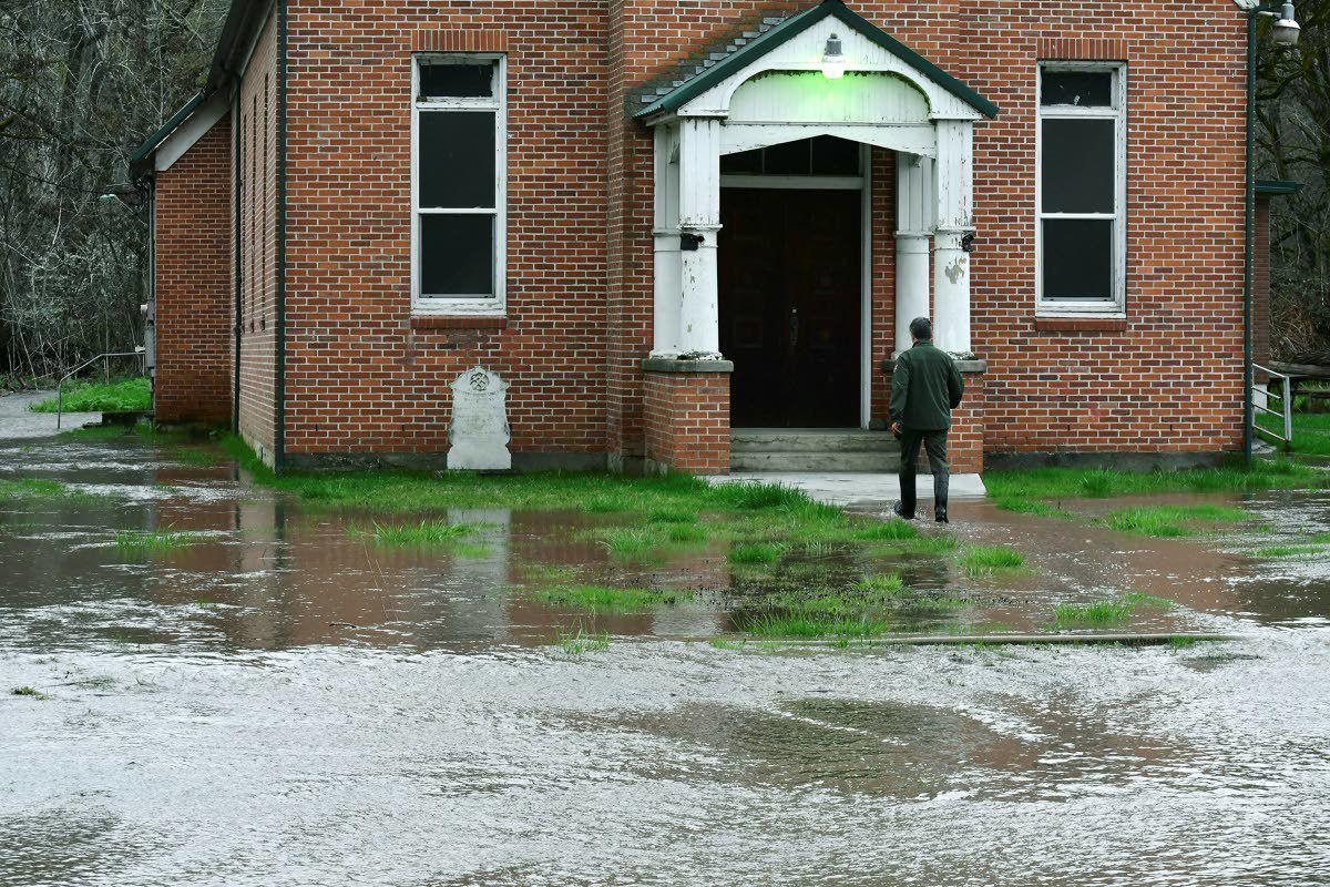 Area floodwaters force rescues, travel warnings