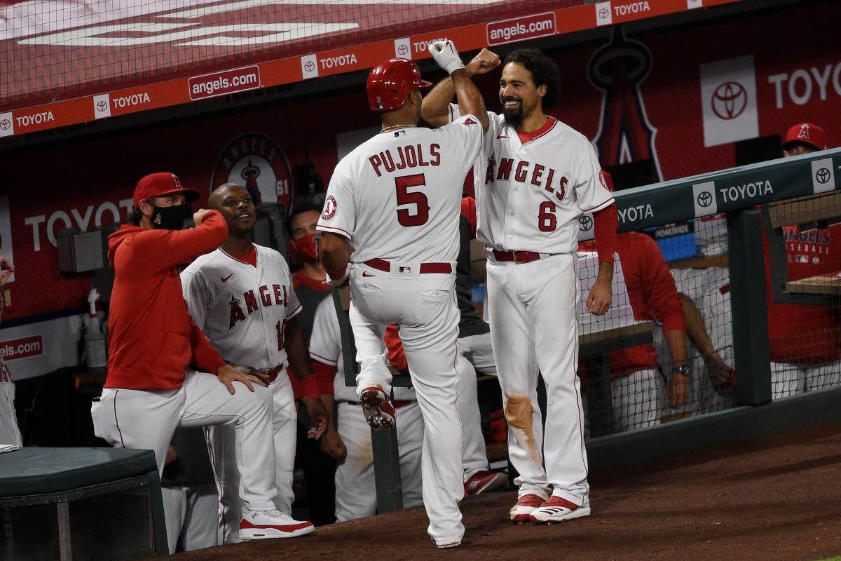 Rendon homers in season debut, Angels rout Mariners