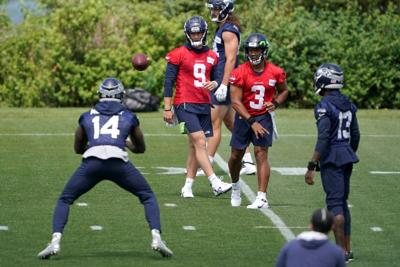 Metcalf back with Seahawks after testing sprint waters