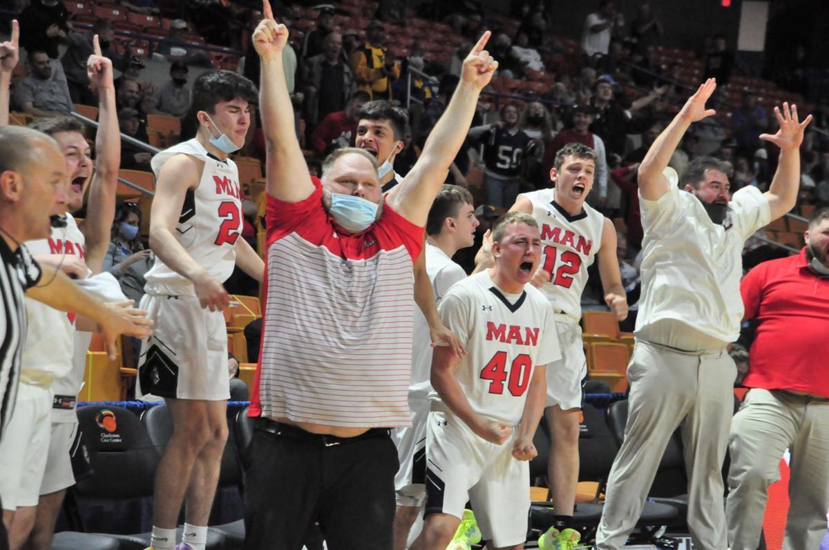 Man PC Coach TJ Blevins celebrates BEST