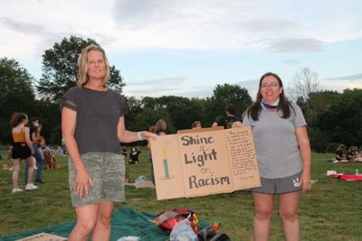 Large crowd turns out in Round Hill for a peaceful protest, vigil