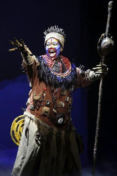 an observation and analysis of the actor buyi zama as rafika in the lion king at the fox theater in  Swiss confederation.