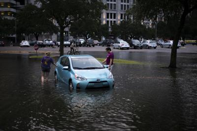 PHOTOS: Flooding from Tropical Depression Nicholas causes distress for students parked on campus