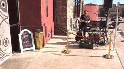 Musician holds curbside concert at the Funky Door