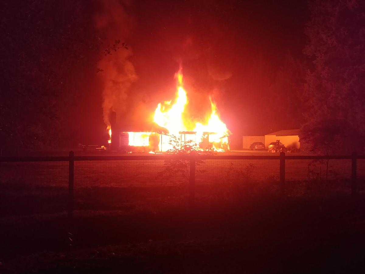 Ten Mile Road house burns early Monday; no one inside