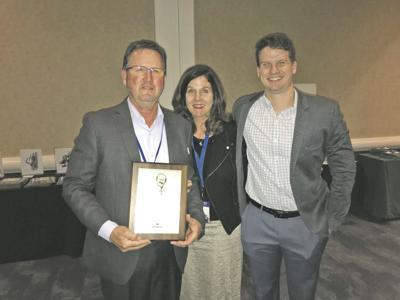 Tribune's Lewis receives Master Editor/Publisher award