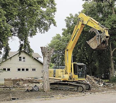 Demolition crew tears down house in FEMA program