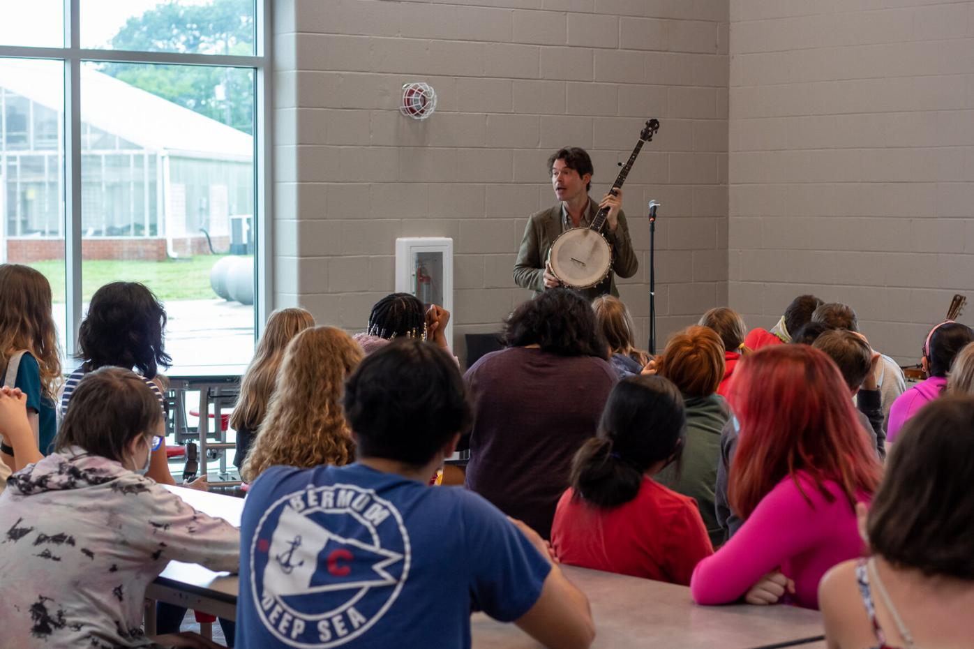 Ketch Secor speaks to music students gathered at Overton High School