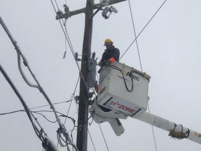 Nashville Electric worker servicing an electric pole