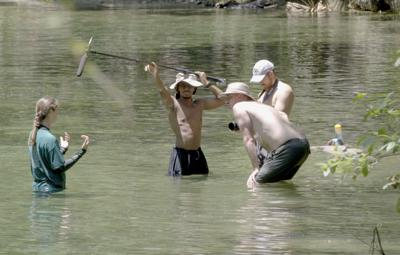 Documentary filming in a river