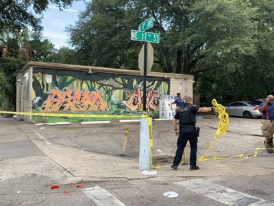 Police clean up shooting site