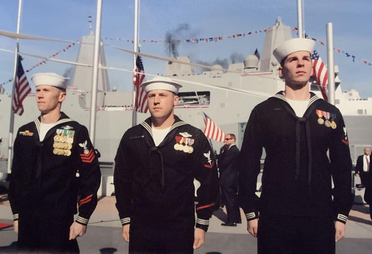 Sailors stand at attention at commissioning of USS New York